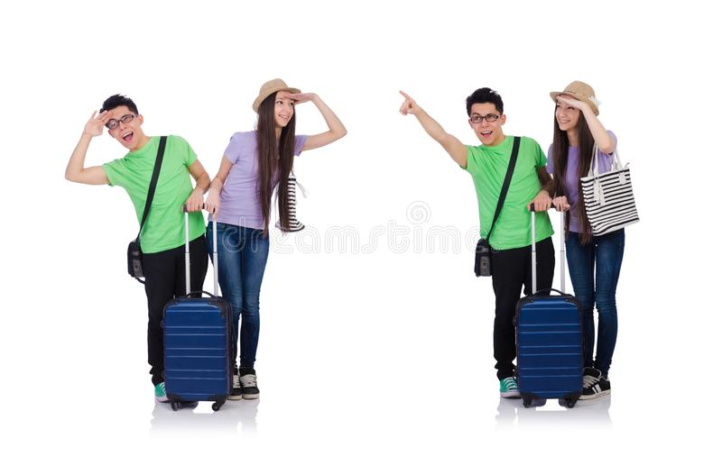 Muchacha y muchacho con la maleta aislada en blanco foto de archivo libre de regalías