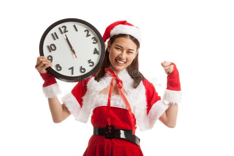 Muchacha y reloj asiáticos de Santa Claus de la Navidad en la medianoche imagenes de archivo