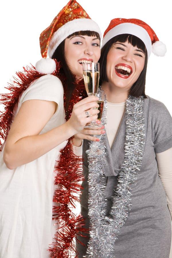 Muchachas de la Navidad con champán imagen de archivo libre de regalías