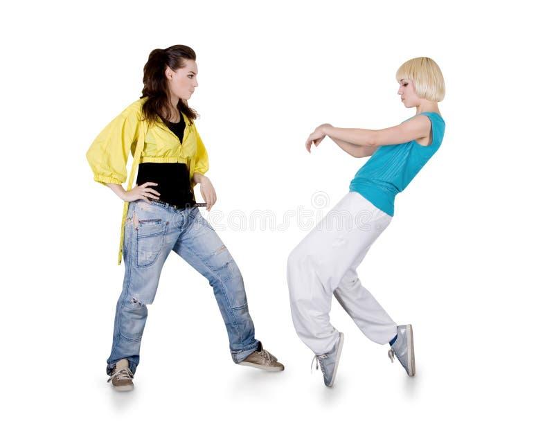 Muchachas del adolescente que bailan el hip-hop sobre blanco imagen de archivo