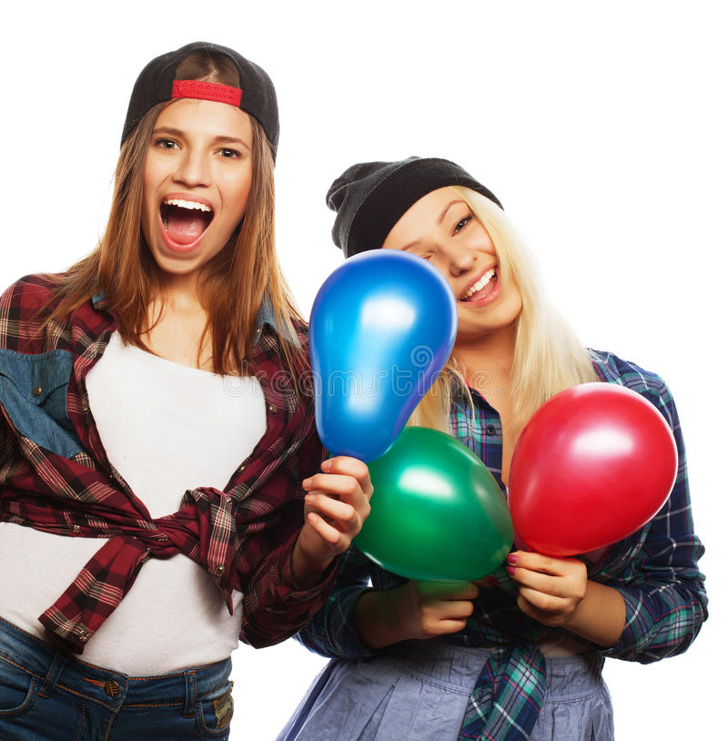 Muchachas del inconformista que sonríen y que sostienen los globos coloreados fotos de archivo libres de regalías