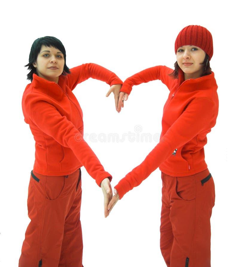 Muchachas en corazón rojo de la demostración imagen de archivo