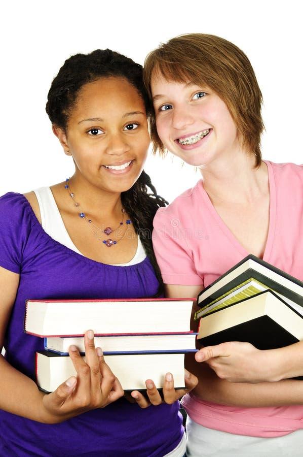 Muchachas que sostienen los libros de texto imagen de archivo libre de regalías