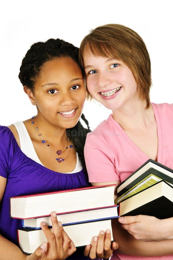 Muchachas que sostienen los libros de texto imagen de archivo