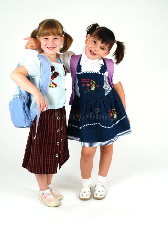 Muchachas sonrientes bonitas de la escuela foto de archivo