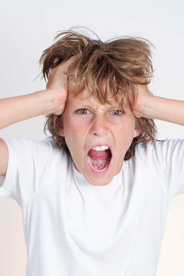 Muchacho adolescente frustrado enojado foto de archivo libre de regalías