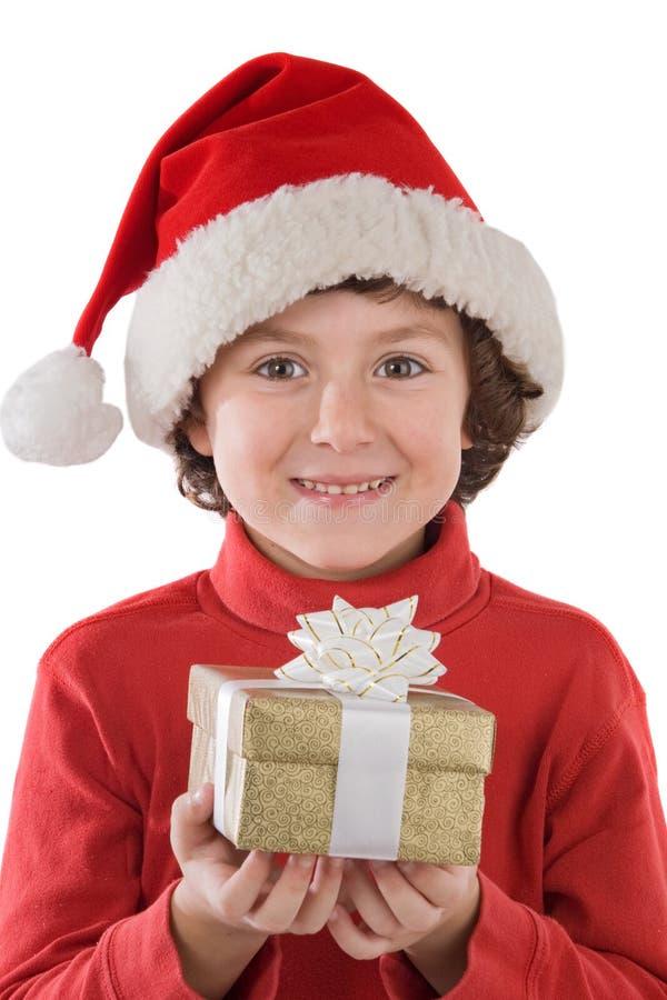 Muchacho adorable con el sombrero rojo de la Navidad y de un GIF fotos de archivo