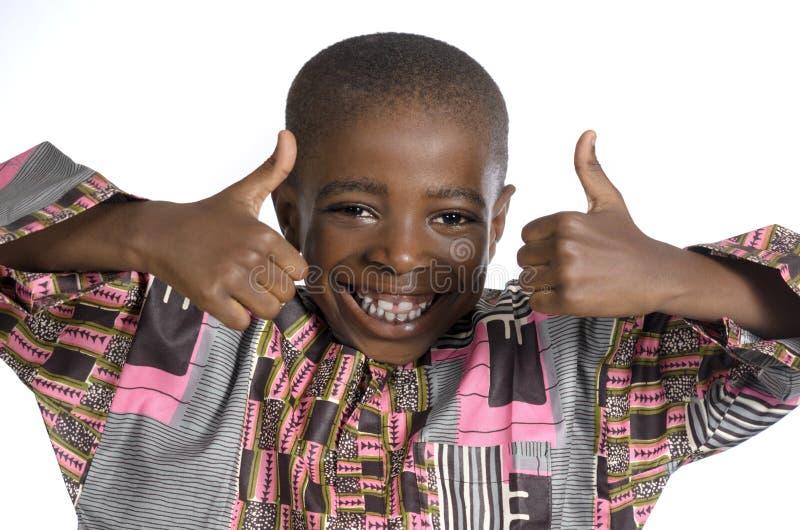 Muchacho africano que muestra el pulgar para arriba imágenes de archivo libres de regalías