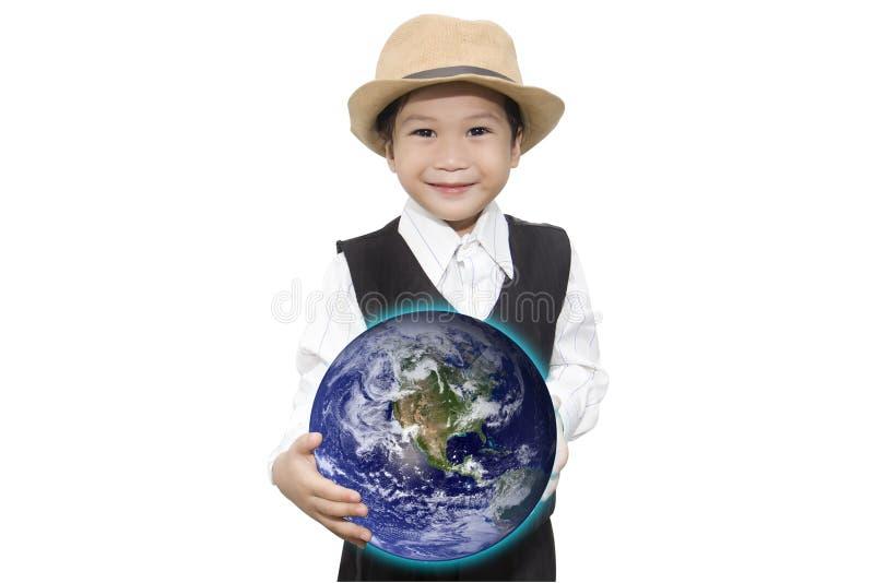 Muchacho asiático con los elementos del holograma del globo de D a mano de esta imagen a foto de archivo