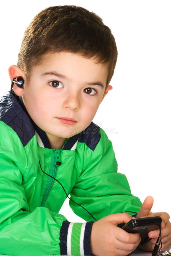 Muchacho con el auricular fotografía de archivo