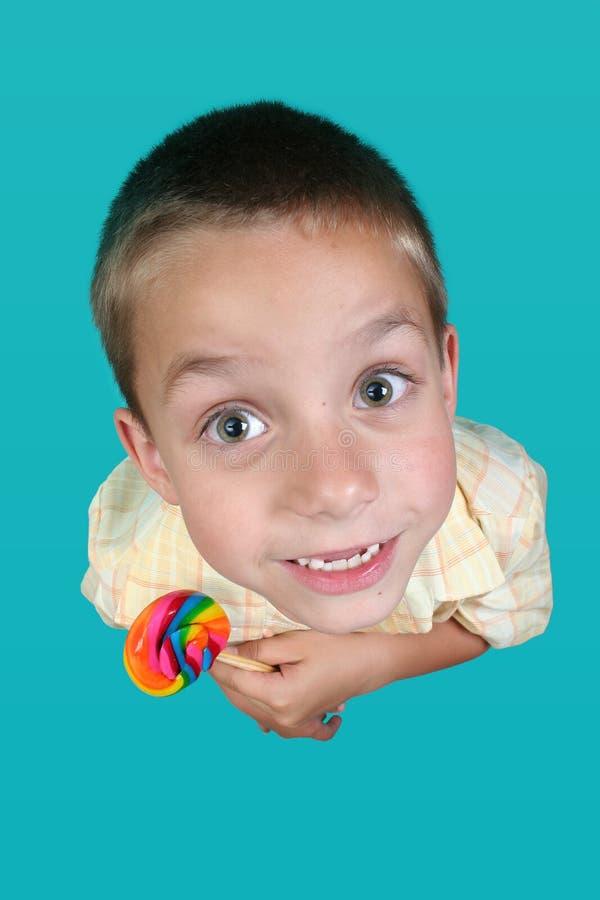 Muchacho con el caramelo fotos de archivo
