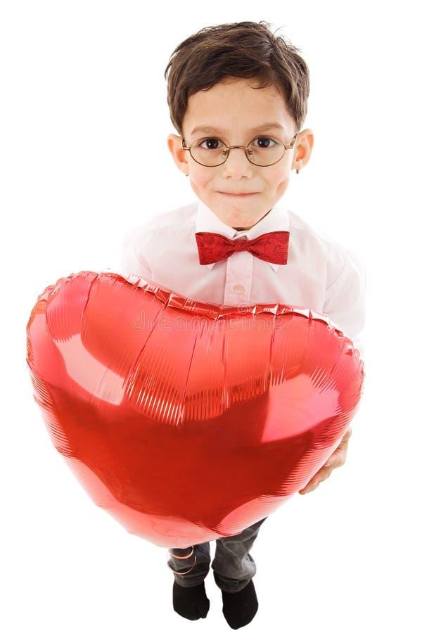 Muchacho con el globo rojo imagenes de archivo
