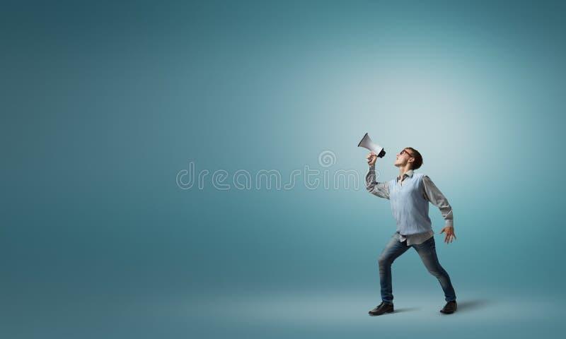 Muchacho con el megáfono fotos de archivo