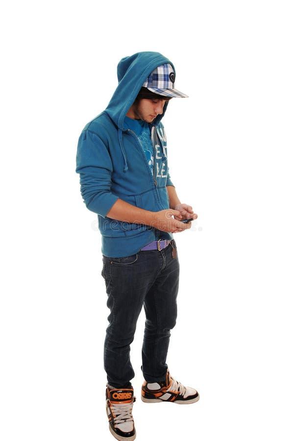 Muchacho con el teléfono celular. fotografía de archivo
