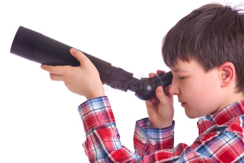 Muchacho con el telescopio imagen de archivo