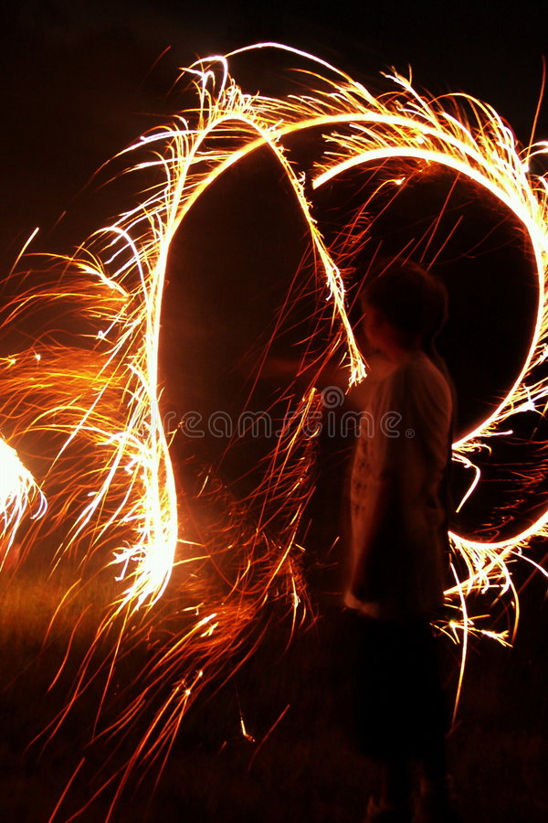 Download Muchacho con los Sparklers foto de archivo. Imagen de asombro - 190742
