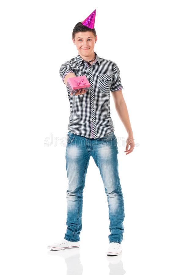 Muchacho del estudiante con el casquillo del cumpleaños foto de archivo libre de regalías