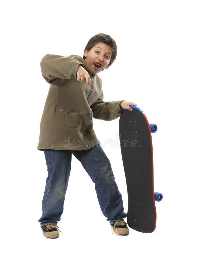 Muchacho del patinador con la cara divertida fotografía de archivo