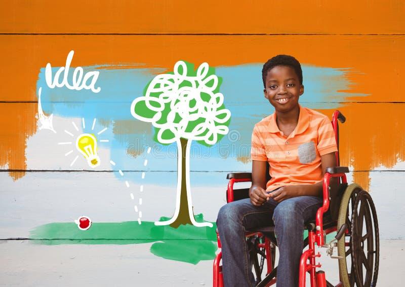 Muchacho discapacitado en silla de ruedas con los dibujos coloridos de la idea fotografía de archivo