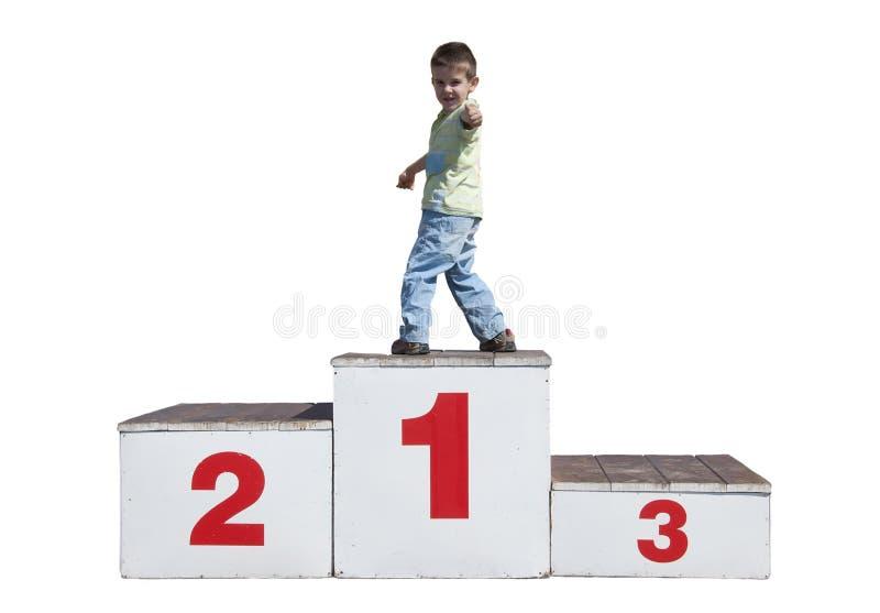 Muchacho en el podium imagen de archivo libre de regalías