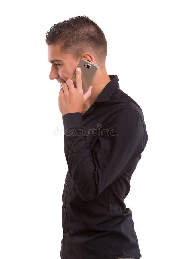 Muchacho en el teléfono imagenes de archivo