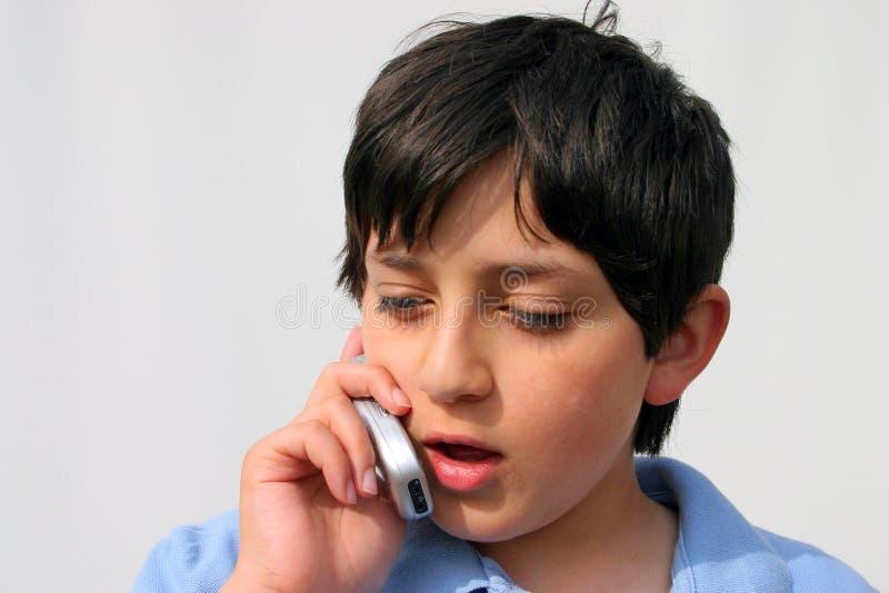 Muchacho en el teléfono celular foto de archivo libre de regalías