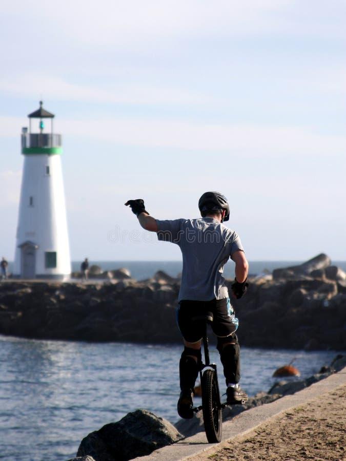 Muchacho En El Unicycle En Una Playa De California Imagen de archivo libre de regalías