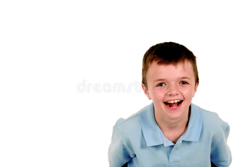 Muchacho en la risa azul de la camisa foto de archivo libre de regalías