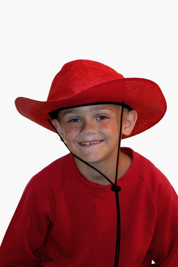 Muchacho en rojo imagenes de archivo