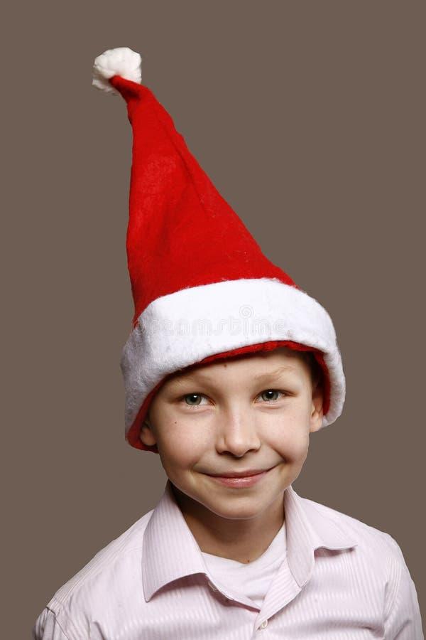 Muchacho en un casquillo del Año Nuevo foto de archivo libre de regalías