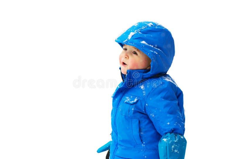Muchacho en un mono de nieve que mira para arriba - aislado fotos de archivo libres de regalías