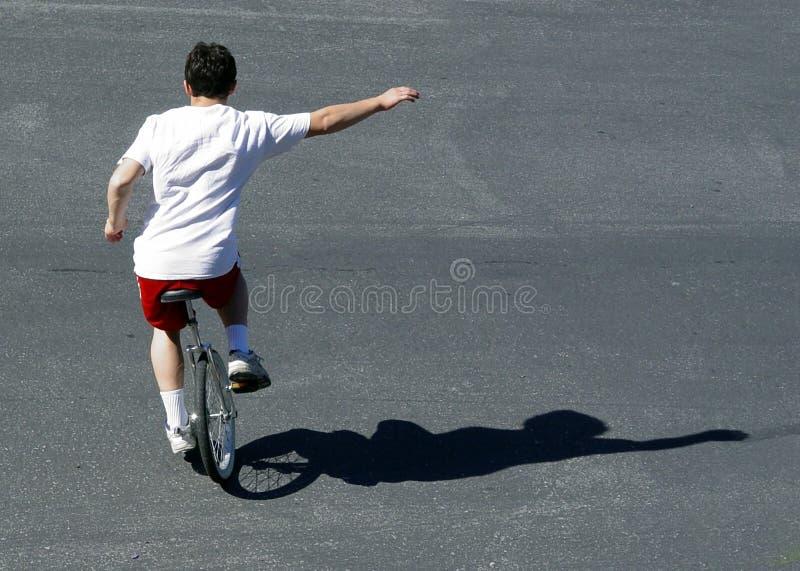 Muchacho En Un Unicycle Imagen de archivo libre de regalías