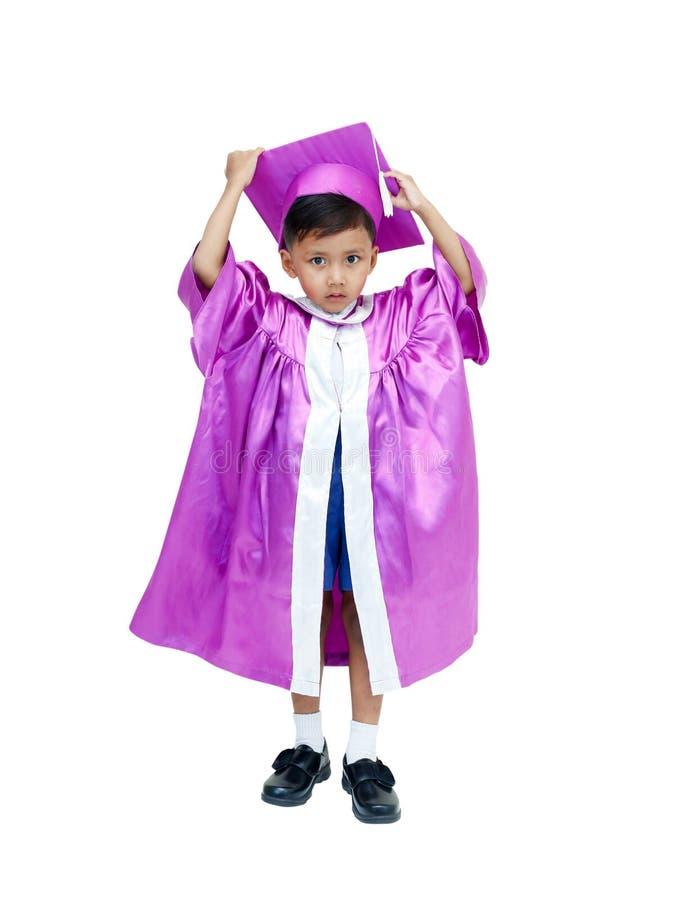 Muchacho en vestido de la graduación fotos de archivo libres de regalías