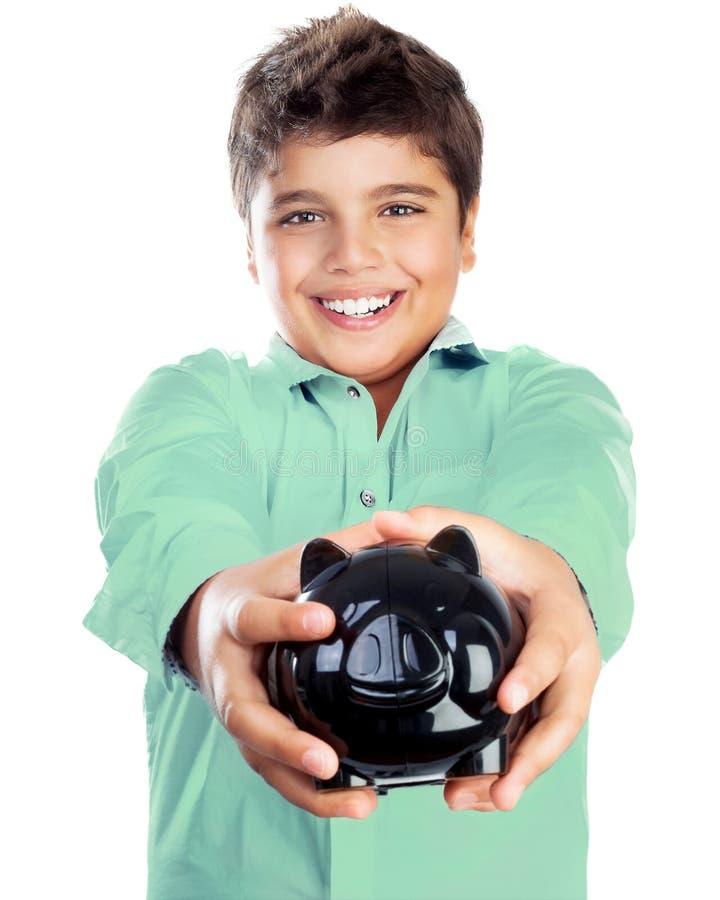 Muchacho feliz con la hucha foto de archivo