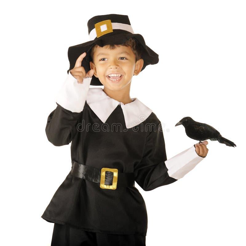 Muchacho feliz del peregrino con el pájaro imagen de archivo libre de regalías