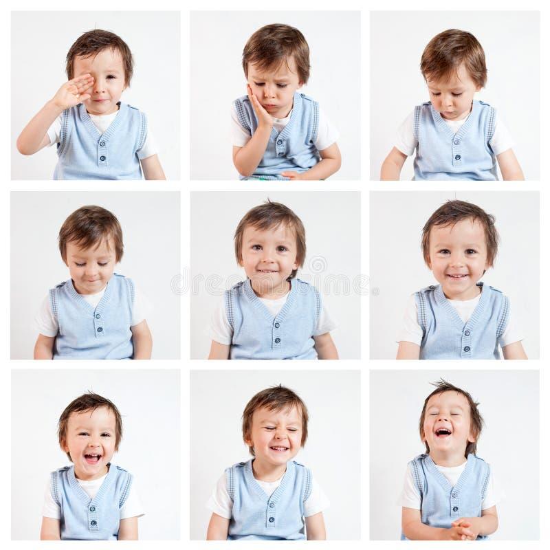 Muchacho, haciendo caras divertidas en un fondo blanco imagen de archivo
