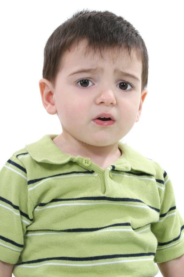 Muchacho infeliz del niño sobre blanco fotografía de archivo