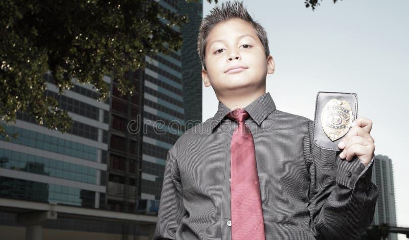 Muchacho joven con una divisa imágenes de archivo libres de regalías