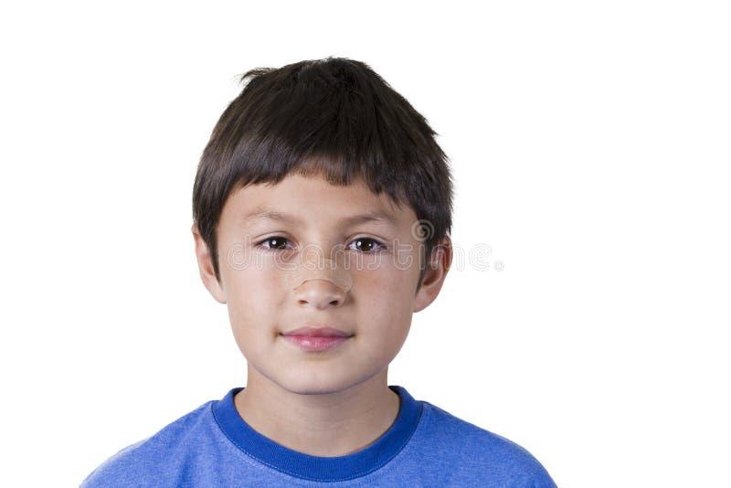 Muchacho joven con yeso en nariz foto de archivo libre de regalías