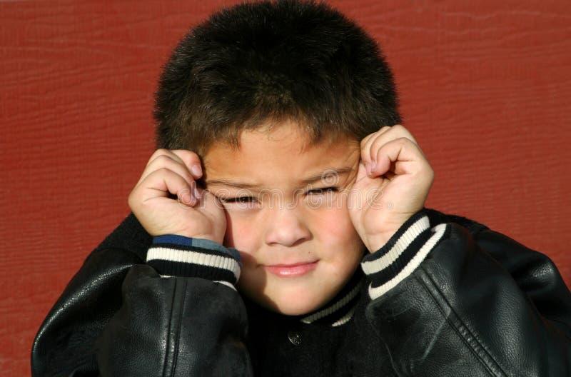Muchacho joven confundido fotografía de archivo
