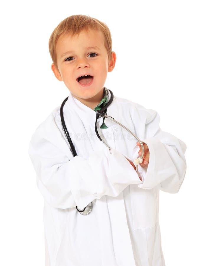 Muchacho joven en equipo de los doctores fotografía de archivo libre de regalías