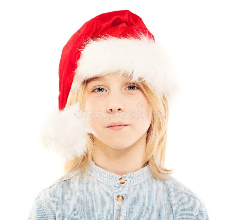 Muchacho joven en Santa Hat Isolated Niño de la Navidad fotografía de archivo libre de regalías