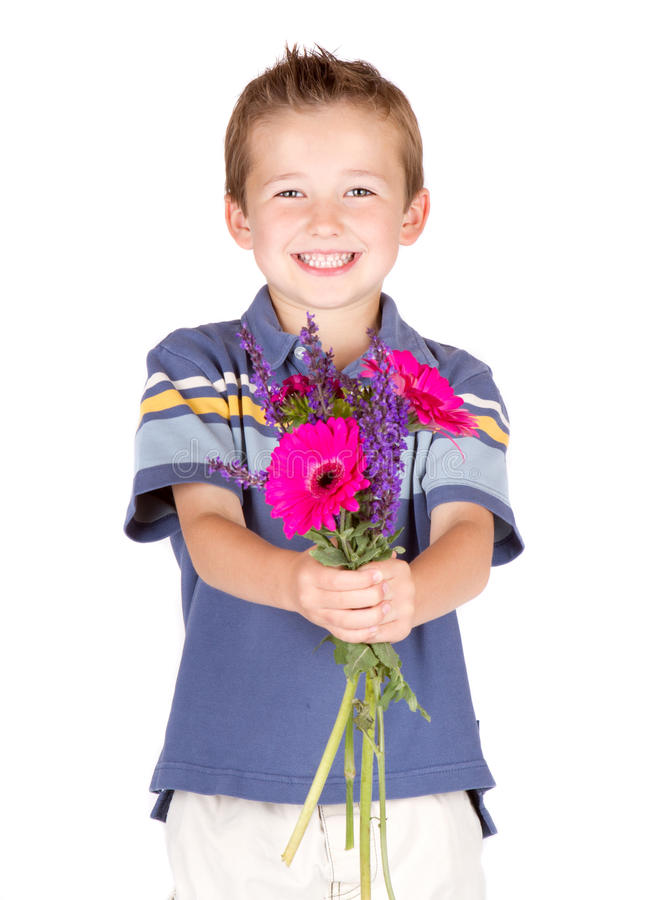 Muchacho joven que da las flores fotografía de archivo libre de regalías