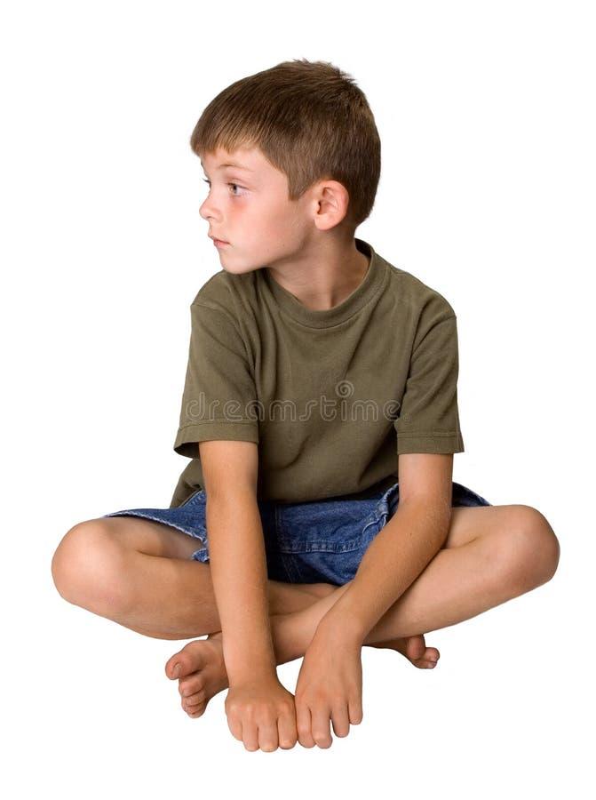 Muchacho joven que parece aburrido fotografía de archivo libre de regalías