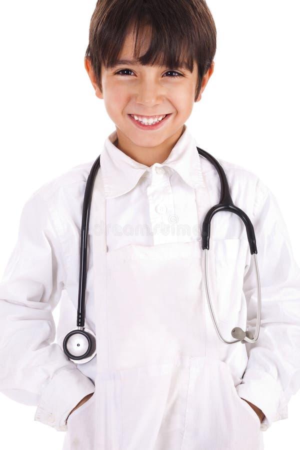 Muchacho joven vestido como doctor fotografía de archivo