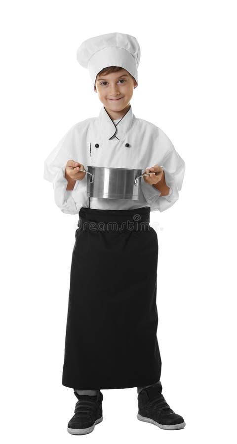 Muchacho lindo en uniforme del cocinero imagenes de archivo