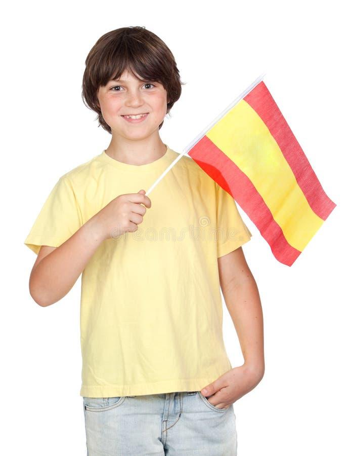 Muchacho pecoso con el indicador español fotografía de archivo
