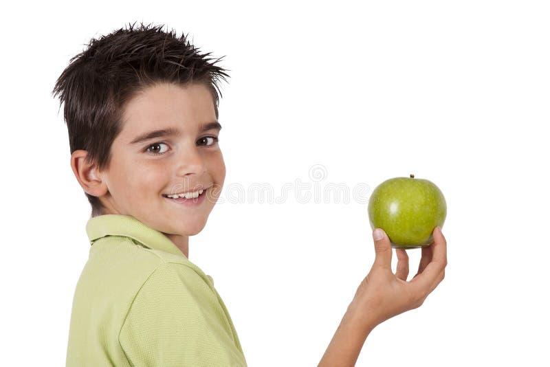 Muchacho que come la manzana fotos de archivo libres de regalías