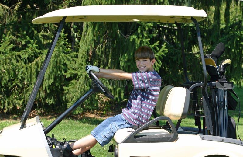 Download Muchacho Que Conduce El Carro Imagen de archivo - Imagen de cara, golfing: 1280875