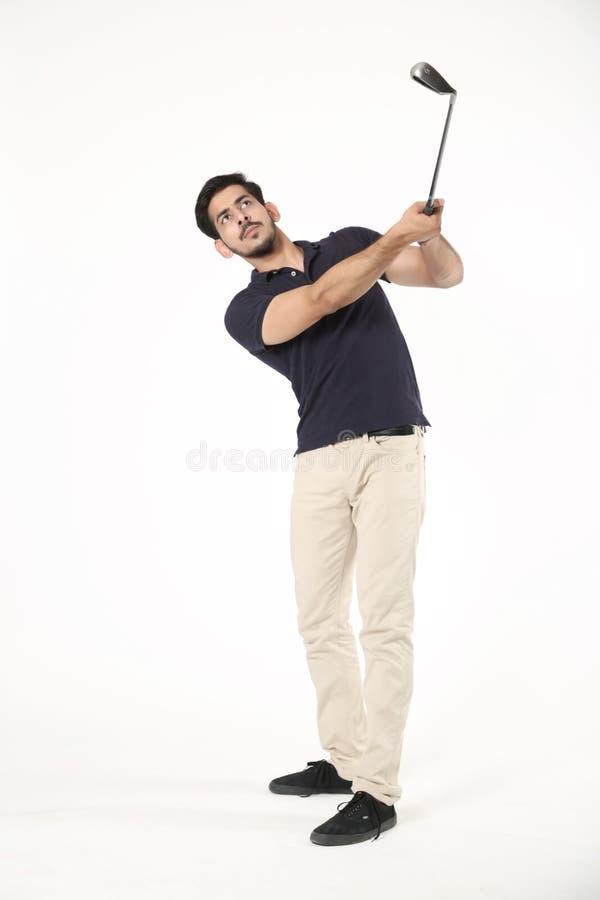 Muchacho que juega con el palillo del golf fotografía de archivo